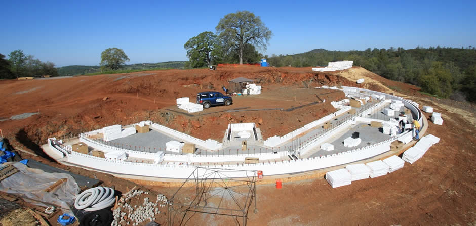 April 4, 2009<br/><br/>The ICF forming begins.<br/><br/>The IntegraSpec ICF independent panel forming system allows the installers to create this wide radius, cistern wall, and straight perimeter wall with ease.